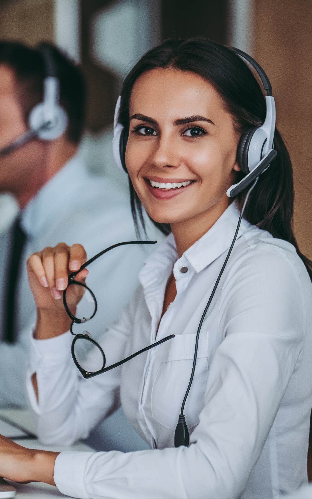 a call center representative smiling tall header image